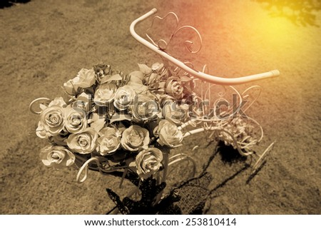 Bouquet of rose flower  with bicycle. Vintage filter. - stock photo