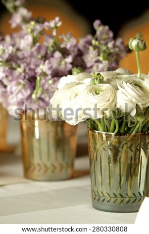 Bouquet of rose flowers in glass vase - stock photo