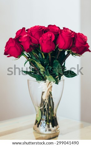 Bouquet of roses in a glass vase - stock photo