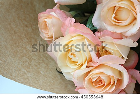 bouquet of roses in a kraft paper