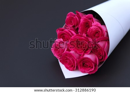 Bouquet of roses on a black background. Greeting template background for greeting card, gift, present