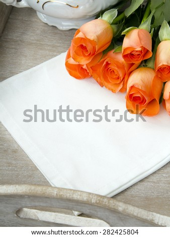 bouquet of roses on a white napkin