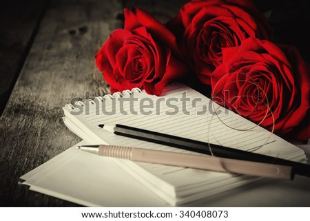 Bouquet of  Roses on Old Wooden Table,Letter to Memory.Toned Image.Selective Focus.Retro Style.