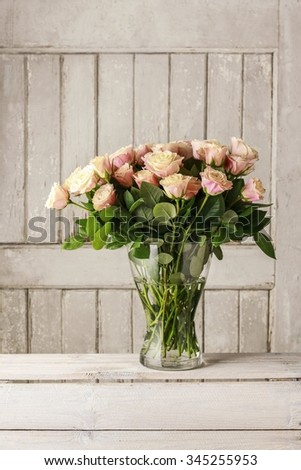 Bouquet of roses on wooden background
