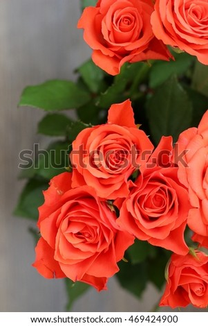 Bouquet of roses on wooden table
