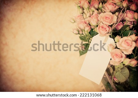 bouquet of roses with a letter of congratulations - stock photo