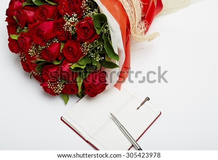 bouquet of roses with a note book.