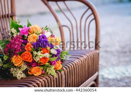 Bouquet of special color roses on a chair and interesting blured background