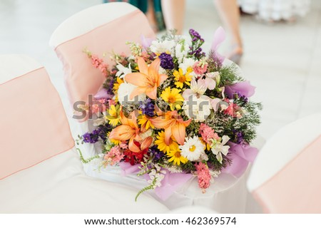 bouquet of spring flowers in a gift package for newlyweds