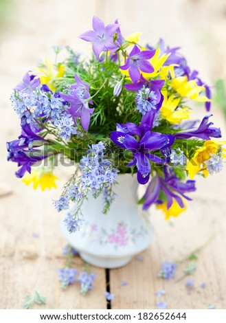 Bouquet of spring flowers in country style. - stock photo
