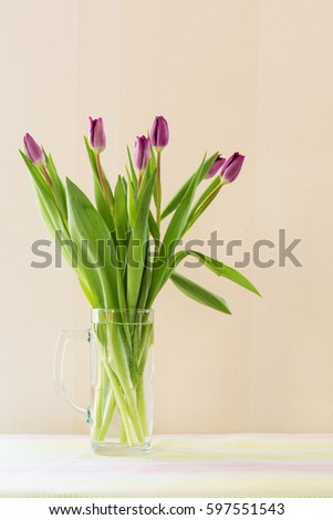Bouquet of spring flowers, purple or lilac tulips.