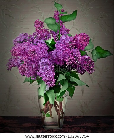 Bouquet of spring purple Lilac in a vase. Still life - stock photo