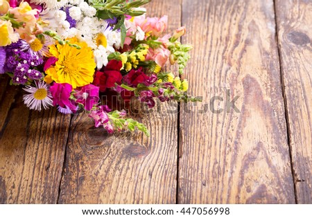 bouquet of summer flowers on wooden table