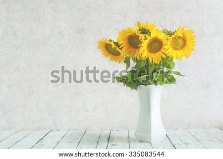 bouquet of sunflowers in a vase . gift. a stylish minimalist design . space for inscriptions . - stock photo