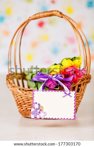 bouquet of tulips in a basket. card for congratulations