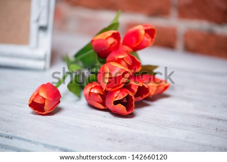 bouquet of tulips on a white table