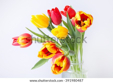 bouquet of tulips on a wooden table background. Top view. For Mother's Day, Women's Day and wedding with copy space for text