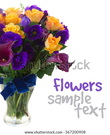Bouquet of violet calla lilly, orange roses and blue eustoma fresh flowers in glass vase close up isolated on white background - stock photo