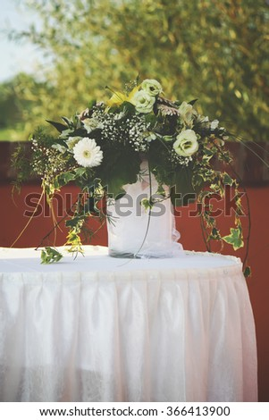 Bouquet of white garden flowers on the table. Decoration outdoors.