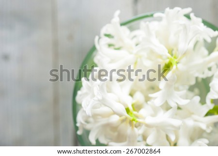 bouquet of white hyacinths on weathered wood background