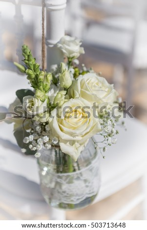 Bouquet of white roses. At the wedding.