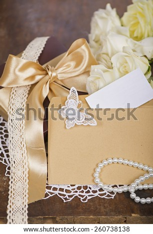 bouquet of white roses, blank greeting card, gift on a wooden board - stock photo