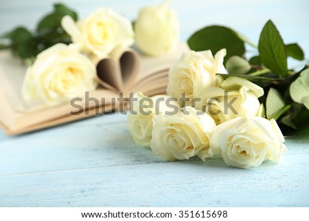 Bouquet of white roses on blue wooden background - stock photo
