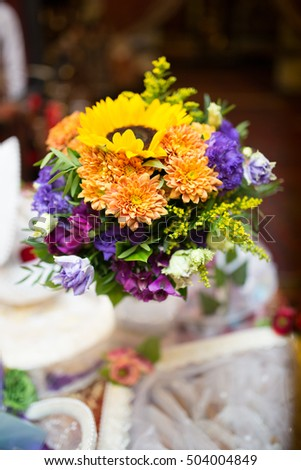 Bouquet yellow purple flowers florist hands stock photo download bouquet of yellow and purple flowers florist hands handmade beautiful wedding celebration mightylinksfo