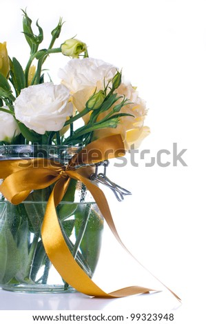 Bouquet of yellow eustoma flowers in a glass jar on a white background - stock photo