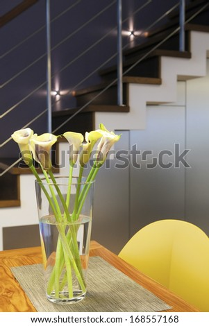 Bouquet of yellow flowers on the table - stock photo