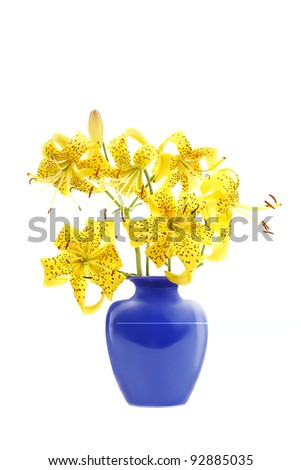 bouquet of yellow lilies in blue jar isolated on white
