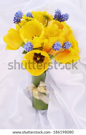 Bouquet of yellow tulips and blue muscari