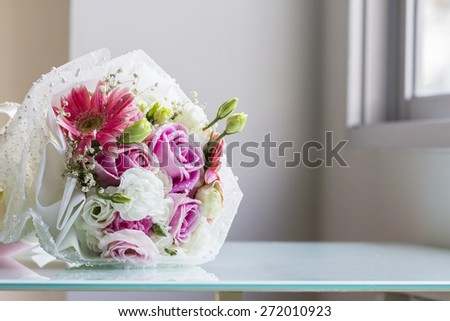 Bouquet on the glass table