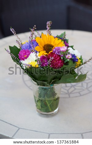 Bouquet on the table in a street cafe - stock photo