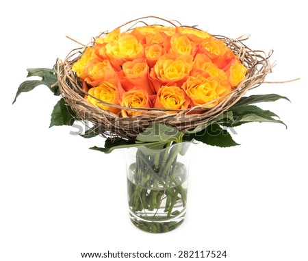 Bouquet orange roses with leaves in glass vase isolated on white background - stock photo