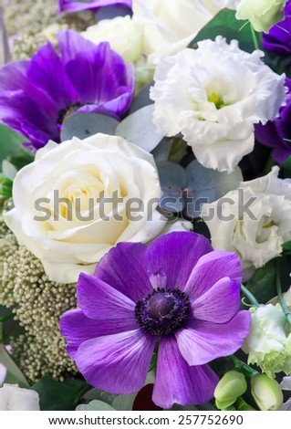 Bouquet. Purple anemone is in the foreground Selective focus with shallow depth of field