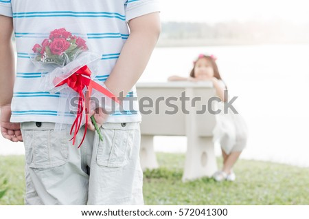 Bouquet Roses in hand man for little bride, Valentine's concept