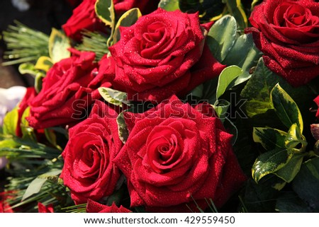 Bouquet with big red roses after a rain shower - stock photo