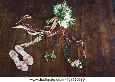 bouquet with peonies, boutonnieres, female leather shoes and wedding rings on dark wooden background - stock photo