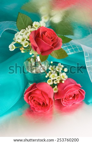 Bouquet with  red roses in a glass vase - stock photo