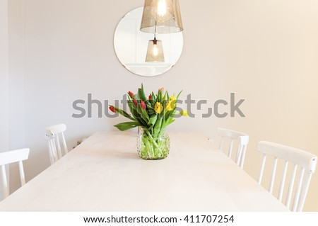 bouquet with tulips on the kitchen table - stock photo