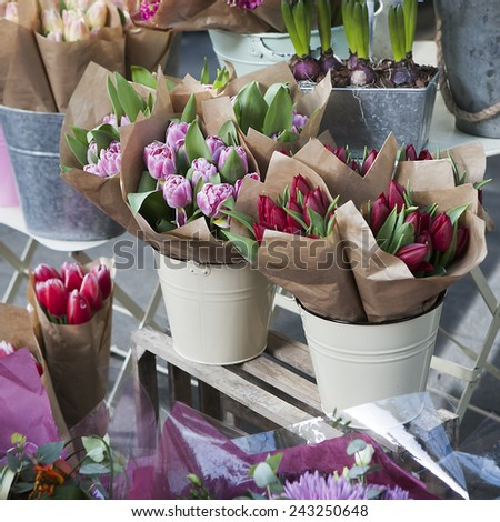 bouquets of colorful spring flowers. tulip, ranunculus, hyacinth, daisy, anemone.