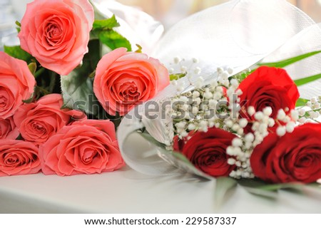 Bouquets of pink, red roses decorated