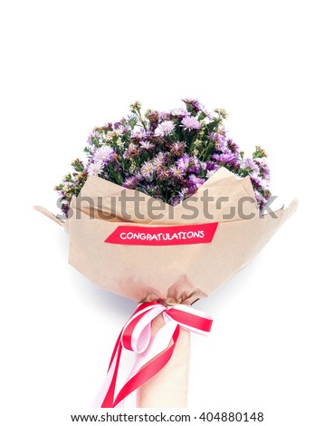 Bouquets of purple Michaelmas daisy flowers in brown color paper on white background - stock photo