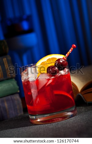 Bourbon Cocktail with Cherry, Bitter and Orange - stock photo