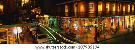 Bourbon Street in the French Quarter at night, New Orleans, Louisiana. - stock photo