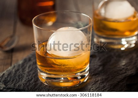 Bourbon Whiskey with a Sphere Ice Cube Ready to Drink - stock photo