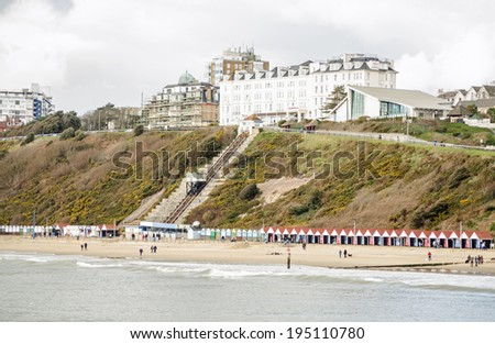 BOURNEMOUTH, ENGLAND - MARCH 1, 2014: Highcliff Hotel on the West Cliff of Bournemouth resort in Dorset.  The West Cliff Railway, a funicular lift carries beach-goers up and down the cliff. - stock photo