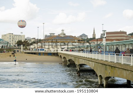 BOURNEMOUTH, ENGLAND - MARCH 1, 2014:  View from Bournemouth pier looking to beach and tethered balloon.   - stock photo