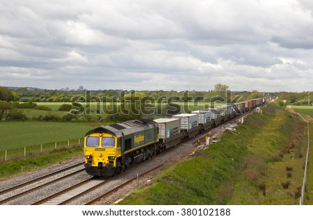 BOURTON, UK - MAY 19: A Freightliner intermodal train passes Bourton on route to Felixstowe docks on May 19, 2015 in Bourton. Freightliner operate a fleet of 80 locos & 1400 wagons